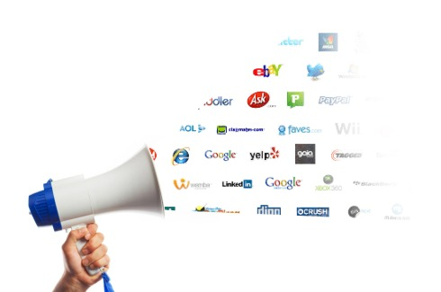 Social media network logos coming out of megaphone