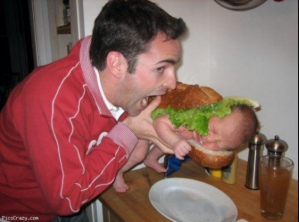 Man eating a baby sandwich