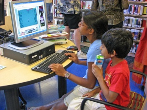 Children using the library computers by San Jose Library