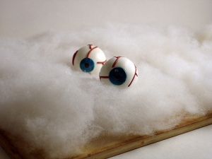 Disembodied Eyeballs on White Cotton