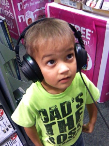 kid listening to headphones