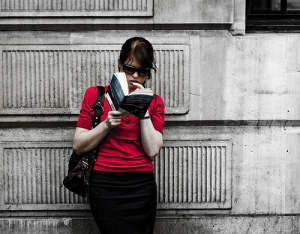 Woman in red reading.