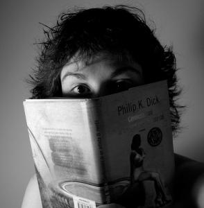 Guilty Face behind book by pianetatschai
